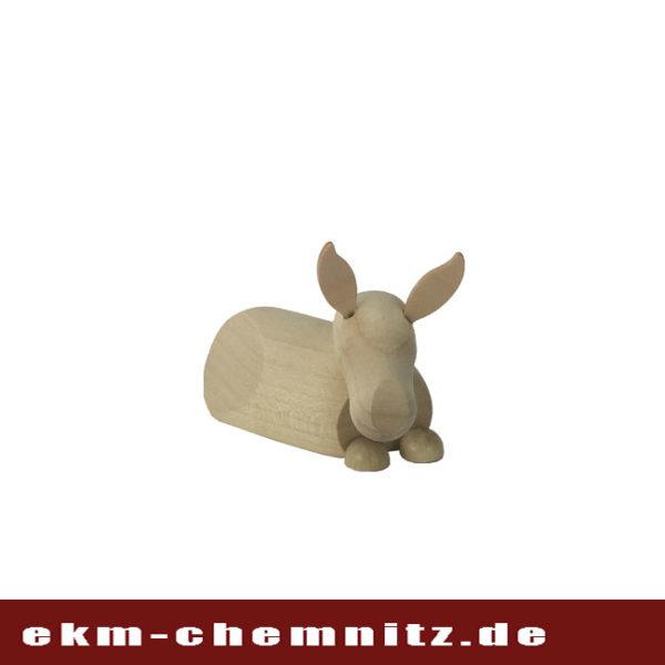Eine handgearbeitete Drechselfigur aus dem Erzgebirge, der Esel groß, naturfarben mit klaren, modernen Stil.