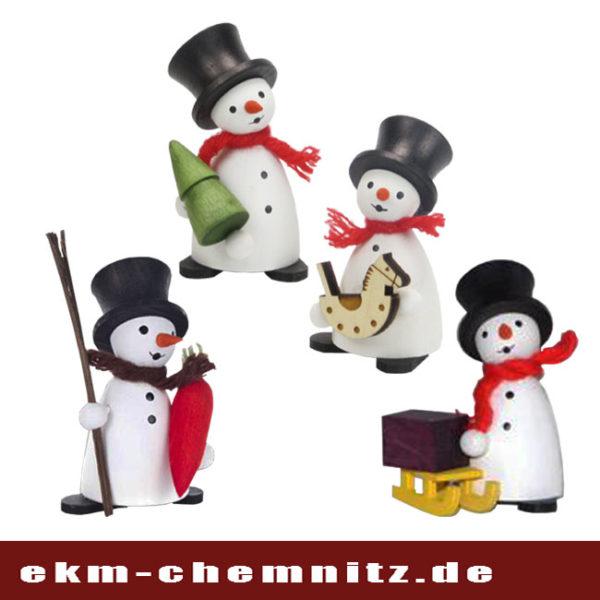 Lustige kleine Drechselfiguren als Schneemänner der Firma Hennig in Deutschneudorf.