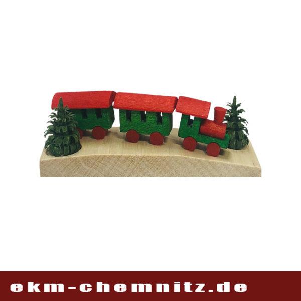 Aus der Rubrik Miniaturen ist diese kleine Eisenbahn in der Farbe grün.