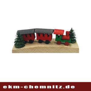 In der Kategorie Miniaturen finden Sie diese kleine Eisenbahn in Rot auf Brettchen.