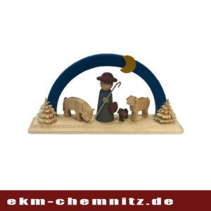 Ein Schäfer mit Hund und Schafen auf einem blauen Miniatur Schwibbogen.